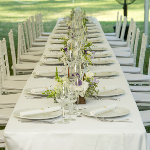 Tables Category 1 White Covered Long Rectangular Table  At Outdoor Event 500sq