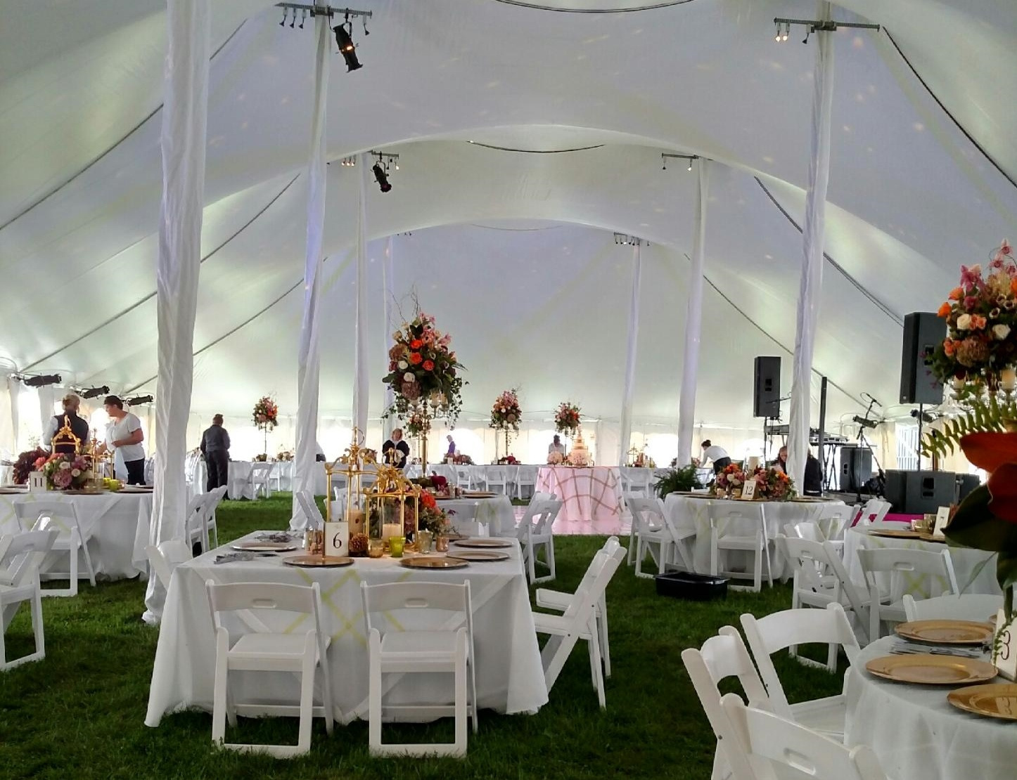 Square And Round Tables Under A Twin Peak Tent For A Wedding The - Wedding table tents