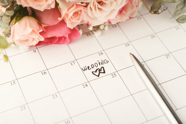 Pink roses on top of a large calendar