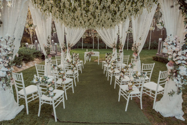 Tented wedding venue with hanging flowers